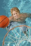 Young Man Playing Water Basketball Royalty Free Stock Photos