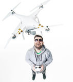 Young man playing a white drone Stock Photography