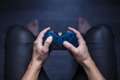 Young Man Playing Xbox One Stock Images