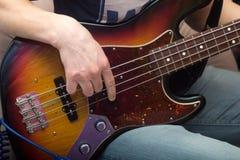 Young man plays bass guitar Royalty Free Stock Photos