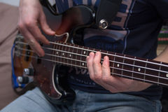 Young man plays bass guitar Royalty Free Stock Images