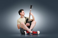 Young man plays the electric guitar Stock Image