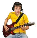 A young man plays the electric guitar Stock Images