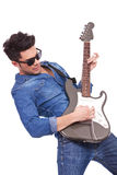 Young man plays electric guitar Royalty Free Stock Image
