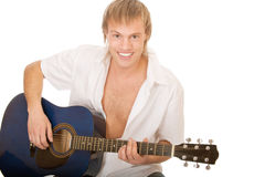 Young man plays guitar Royalty Free Stock Photos