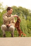 Young man plays with his adorable dachshund Royalty Free Stock Photography