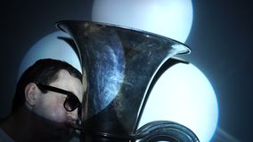A young man plays the tuba. stock footage