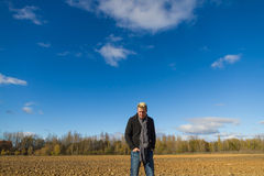 Young man in plowed field Royalty Free Stock Photos