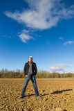 Young man in plowed field Royalty Free Stock Image