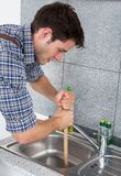Young Man With Plunger Stock Image