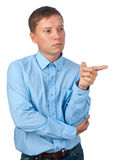 Young man point his finger to... Stock Photo
