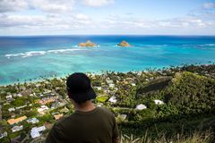 Young man point of view Lanikai from the Pillbox hiking trail Ka. Point of view Lanikai from the Pillbox hiking trail Kailua Hawaii in December Royalty Free Stock Photo