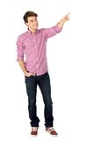 Young man pointing Royalty Free Stock Photos