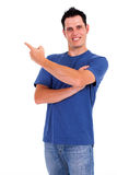 Young man pointing Stock Photography