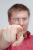 Young man pointing. Downright royalty free stock images