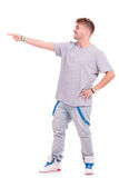 Young man pointing away Stock Image