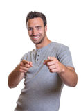 Young man pointing with both hands Stock Image