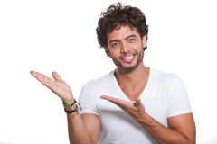 Young man by pointing with both hands. On white background Stock Photo