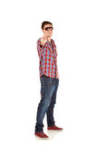 Young man pointing at camera Stock Photography