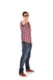 Young man pointing at camera Stock Photography