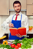 Young man pointing at the cookbook Stock Photo