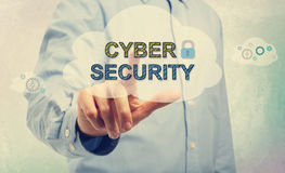 Young man pointing at Cyber Security texts Royalty Free Stock Photo