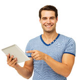 Young Man Pointing At Digital Tablet Royalty Free Stock Photo