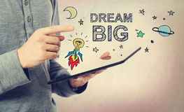 Young man pointing at Dream BIG concept Stock Image