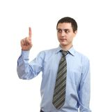 Young man pointing finger Stock Images