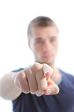 Young man pointing with finger against Royalty Free Stock Photos