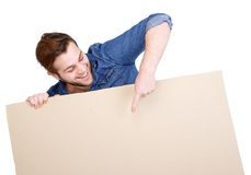 Young man pointing finger on blank poster sign Stock Photography