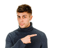 Young man pointing finger Stock Image