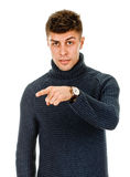 Young man pointing finger Stock Photo