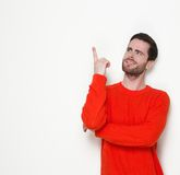 Young man pointing finger up Stock Photo