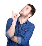 Young man pointing finger up Royalty Free Stock Photos