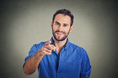 Young man pointing finger at you Royalty Free Stock Photos