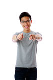 Young man pointing finger at you Stock Photo