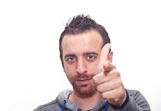 Young man pointing with fingers Stock Photography