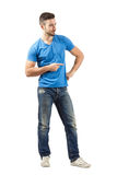 Young man pointing while flirting Stock Image
