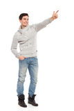 Young man pointing. Stock Images