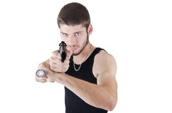Young man pointing gun Stock Images
