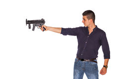 Young man pointing gun Royalty Free Stock Image