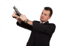 Young man pointing a gun Royalty Free Stock Photo