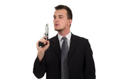Young man pointing a gun Royalty Free Stock Images