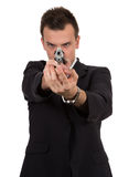 Young man pointing a gun Royalty Free Stock Photography