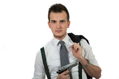 Young man pointing a gun Stock Photos