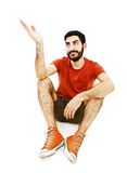 Young man pointing with hand and looking up. Isolated on white background Stock Images