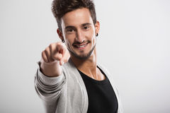 Young man pointing Royalty Free Stock Images