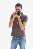 Young man pointing his camera at the camera Royalty Free Stock Images