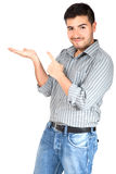 Young man pointing his finger on the copy space. Hispanic man pointing something on his hand royalty free stock image